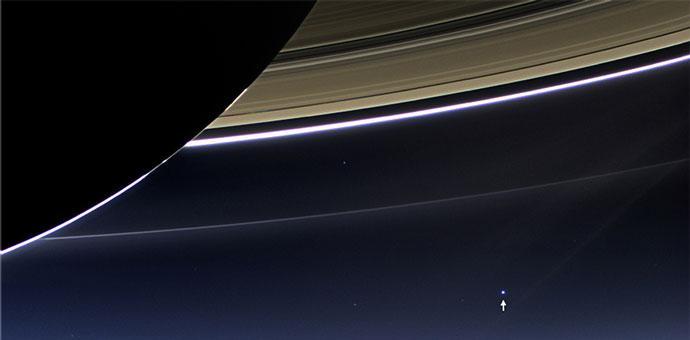 Earth's a tiny blue dot